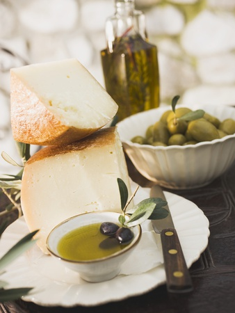 Cheese, Olives and Olive Oil on Table Out of Doors Photographic Print