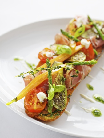 Baguette with Ham, Grilled Vegetables and Pesto Photographic Print by Herbert Lehmann
