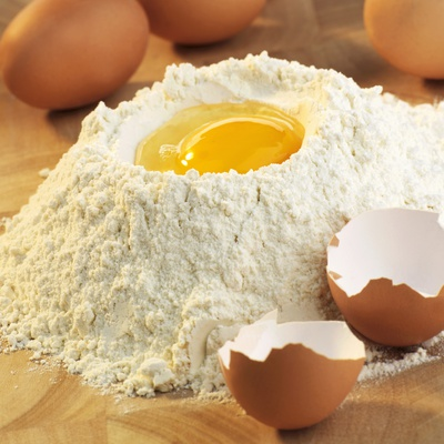 Baking Ingredients: Egg in Well in Mound of Flour Photographic Print by Alexander Feig