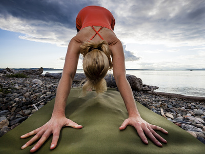 Lisa Eaton Holds a Downward Dog Yoga Pose on the Beach of Lincoln Park – West Seattle, Washington Photographic Print by Dan Holz