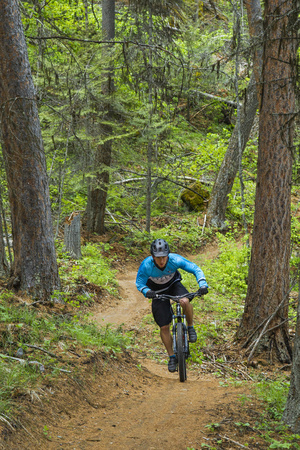 Mountain Biking the Whitefish Trail Near Whitefish, Montana, USA Photographic Print by Chuck Haney