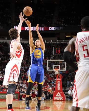 Houston, TX - February 5: Stephen Curry and Omer Asik Photo by Bill Baptist