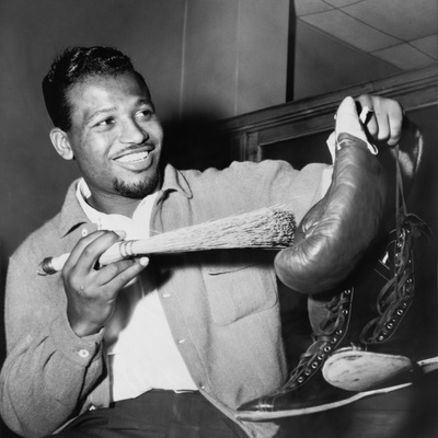 Sugar Ray Robinson Dusting Off His Boxing Gloves for His 1954 Comeback Fight Photo