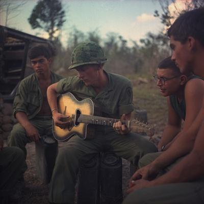 US Army Infantrymen Gather around a Guitar Player and Sing, Vietnam, Jan. 1968 Photo