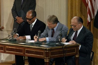 Anwar Sadat, Jimmy Carter, and Menahem Begin Signing Camp David Accords, 1978 Photo