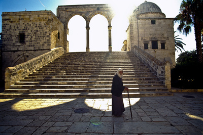 An Elderly Man Walking Behind the Dome of the Rock Photographic Print by Lori Epstein