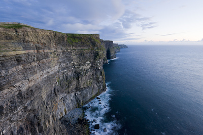 Heavy Clouds Over the Cliffs of Moher and the Atlantic Ocean Photographic Print by Jeff Mauritzen