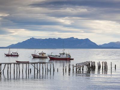 Chile, Magallanes Region, Puerto Natales, Fishing Boats, Seno Ultima Esperanza Bay Photographic Print by Walter Bibikow