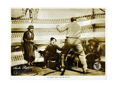 A DAY'S PLEASURE, from left: Edna Purviance, Charlie Chaplin, Tom Wilson on lobbycard, 1919. Prints