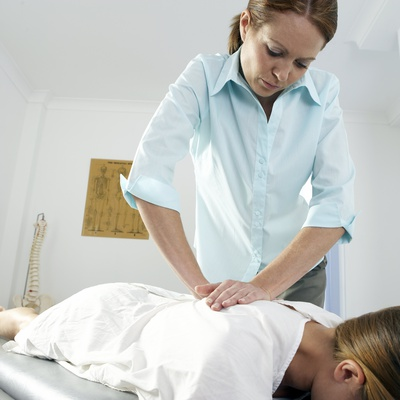 Chiropractic Treatment Photographic Print by Adam Gault