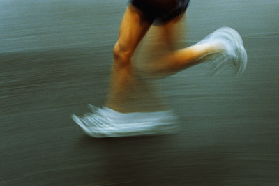 Running Photographic Print by Kevin Curtis