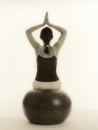 Woman Sitting on Exercise Ball Premium Photographic Print by  Cristina