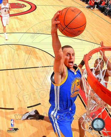 Stephen Curry dunking in the 2010-2011 NBA season in the Golden State Warriors blue uniform