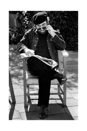Lucio Dalla Looks Towards the Photographer Removing His Glasses Photographic Print