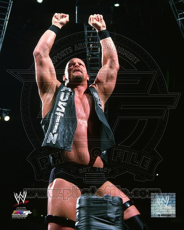Stone Cold Steve Austin standing on ring corner, raising fist and greeting crowd wrestling photo poster