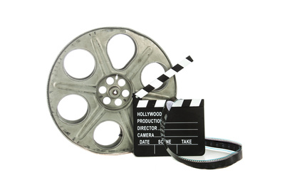 Movie Clapper Board With Film Reel On White Background Poster by Steve Collender