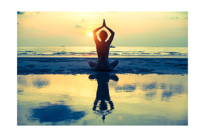 Yoga Woman Sitting In Lotus Pose On The Beach During Sunset Poster by De Visu