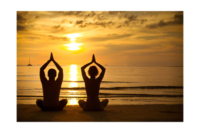 Young Couple Practicing Yoga On The Sea Beach At Sunset Print by De Visu