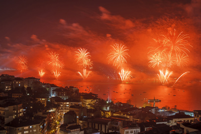 Photo of red sky fireworks display over the Bosphorus, Istanbul, Turkey