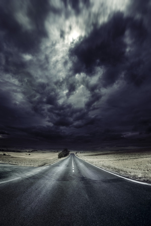 An Asphalt Road with Stormy Sky Above, Tuscany, Italy Photographic Print