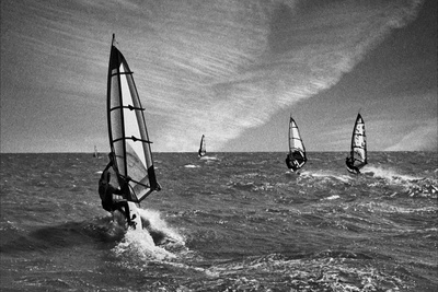 Racing Surfers Photographic Print by Adrian Campfield