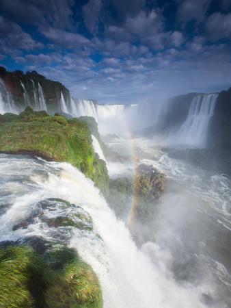 A Rainbow over Iguacu Falls in Brazil Photographic Print by Alex Saberi