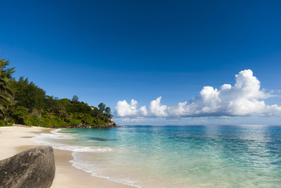 Cumulus Clouds Off the Shore of a Pristine Tropical Beach Photographic Print by Sergio Pitamitz