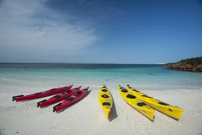 Sea Kayaks Resting on the Beach on Isla Iguana Photographic Print by Michael Melford