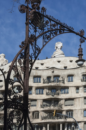 A Wrought Iron Lamp Frames La Pedrera (Casa Mila) Photographic Print by James Emmerson