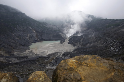 Hot Volcanic Steam Rising into Monsoon Clouds from Kawah Ratu (Queen's Crater) of Mount Tangkuban Photographic Print by Annie Owen