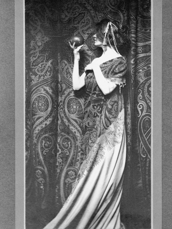 Woman in Long Gown Holding a Pomegranate Photographic Print by Zaida Ben-Yusuf
