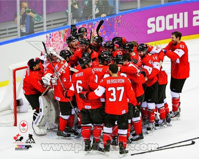 Team Canada celebrates winning the Gold Medal  2014 Winter Olympics Photo