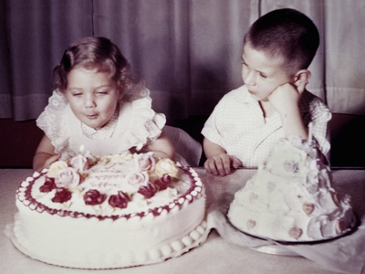 Brother Watches His Sister Blow Out Candles on Birthday Cake, Ca. 1956 Photographic Print