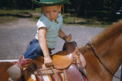 Boy Mounting Horse Photographic Print by William P. Gottlieb