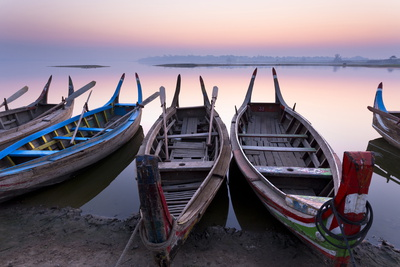 Traditional Rowing Boat Moored on the Edge of Flat Calm Taungthaman Lake at Dawn Photographic Print by Lee Frost