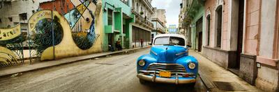 Old Car and a Mural on a Street, Havana, Cuba Photographic Print