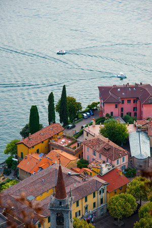 High Angle View of Buildings in a Town at the Lakeside, Varenna, Lake Como, Lombardy, Italy Photographic Print by Green Light Collection