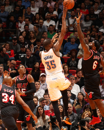Photo of Kevin Durant taking a shot against LeBron James blocking, January 29 2014, Oklahoma City Thunder vs Miami Heats, photo by Issac Baldizon