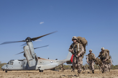 Marines and Sailors Offload from a MV-22 Osprey Photographic Print