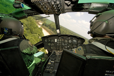 Two Instructor Pilots Practice Low Flying Operations in a Uh-1H Huey Helicopter Photographic Print