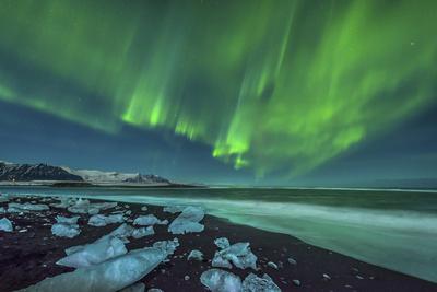 Aurora Borealis over the Ice Beach Near Jokulsarlon, Iceland Photographic Print