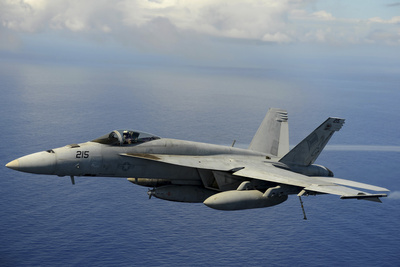 An F-A-18E Super Hornet over the Pacific Ocean Photographic Print