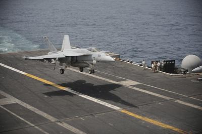 An F-A-18E Super Hornet Lands Aboard the Aircraft Carrier USS Nimitz Photographic Print