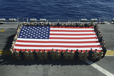 Sailors and Marines Display the National Ensign Aboard USS Kearsarge Photographic Print