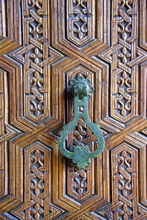 Detail of a Wooden Door and Bronze Knocker Photographic Print by Guy Thouvenin