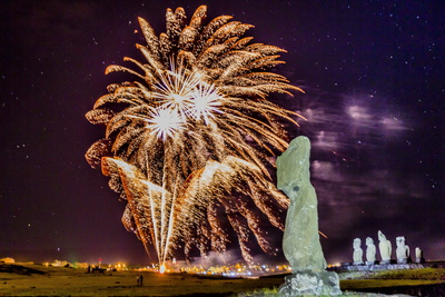 Photo of Fireworks Ringing in the New Year from the Town of Hanga Roa over Moai