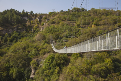 Tourists Crossing Swinging Bridge over Khndzoresk Canyon Photographic Print by Jane Sweeney