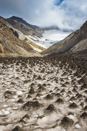 Little Sand Mounds on a Glacier Field on Mutnovsky Volcano, Kamchatka, Russia, Eurasia Photographic Print by Michael Runkel