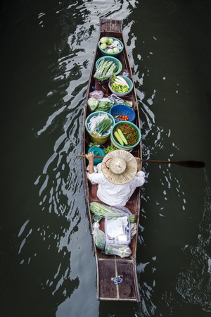 A Vendor Paddles their Boat, Damnoen Saduak Floating Market, Thailand, Southeast Asia, Asia Photographic Print by Andrew Taylor