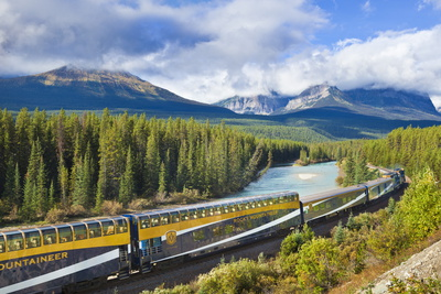 Rocky Mountaineer Train at Morant's Curve Near Lake Louise in the Canadian Rockies Photographic Print by Neale Clark